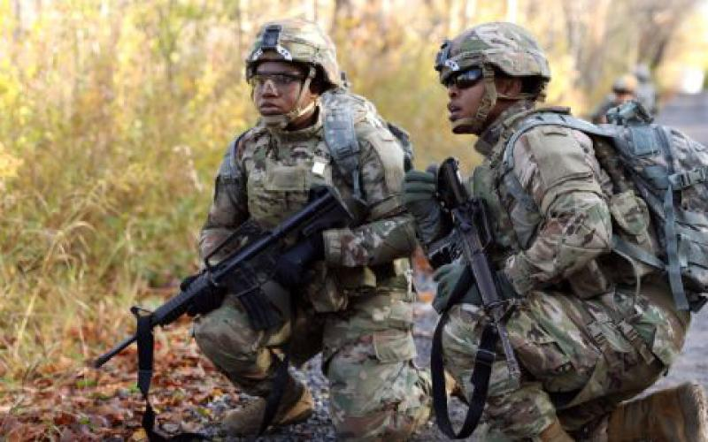 Soldiers with the 10th Mountain Division, Fort Drum, New York, survey an obstacle during an evaluation of the modular scalable vest generation II. The U.S. Army's Army Research Laboratory (ARL) is working on developing personal and vehicle protective gear using new materials for harsh combat conditions.  ARL photo