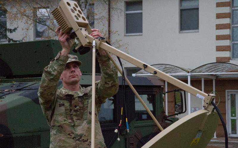 A U.S. Army Reserve information technology specialist installs a satellite receiver in an exercise in Kaiserslautern, Germany. Urban areas, which may be battlegrounds in future conflicts, often are rife with various municipal and industrial sensors that could provide vital data to Army networks under the ARL's Internet of Battlefield Things (IoBT) research work.