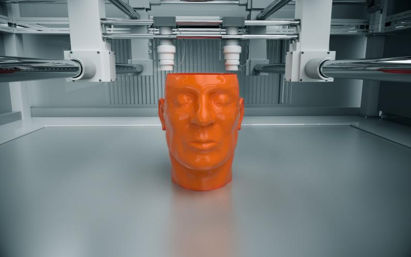 A 3D printed model of a human head takes shape on an additive manufacturing stand. The creation of custom-made human body parts may be the next big market for additive manufacturing.  Shutterstock/Dabarti CGI