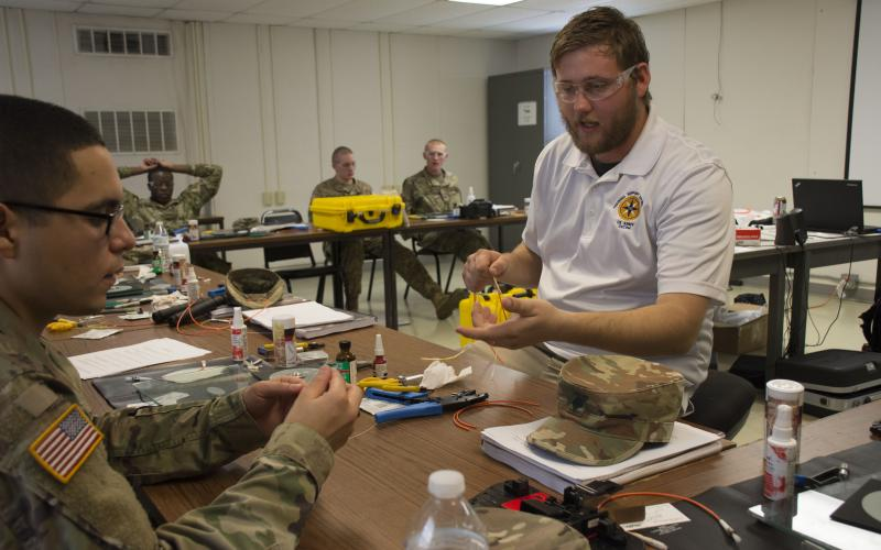 A contracted instructor teaches soldiers how to splice a fiber cable during a Fort Hood Signal University class. Giving soldiers extensive knowledge of their network would have the effect of returning network ownership to its users.
