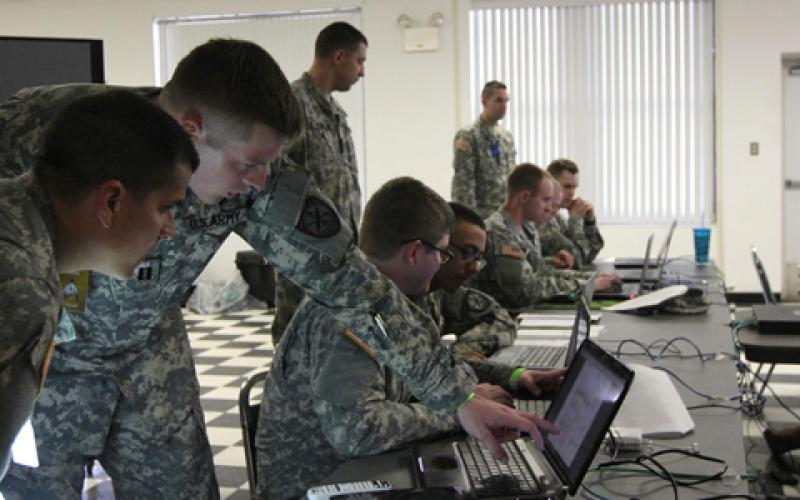 Soldiers of the U.S. Army's 780th Military Intelligence Brigade take part in a cyber development and mentorship exercise at Fort Meade, Maryland. Army cyber is experiencing a convergence of intelligence, electronics and communications disciplines.