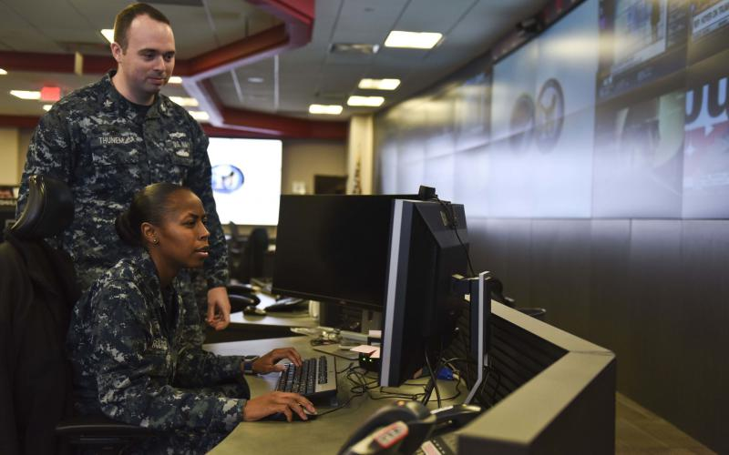 Two U.S. Navy sailors stand watch over systems at the Navy's Fleet Cyber Command. Congress has granted a new Cyber Excepted Service hiring practice that benefits DISA in its efforts to improve cybersecurity across the Defense Department.