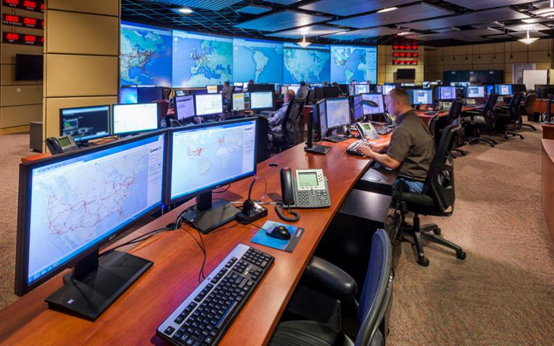 Officials in a telecommunications control room monitor network activity. Having accurate situational awareness of optical fiber traffic is a key to maintaining connectivity amid a range of threats, both accidental and deliberate. Credit: CenturyLink