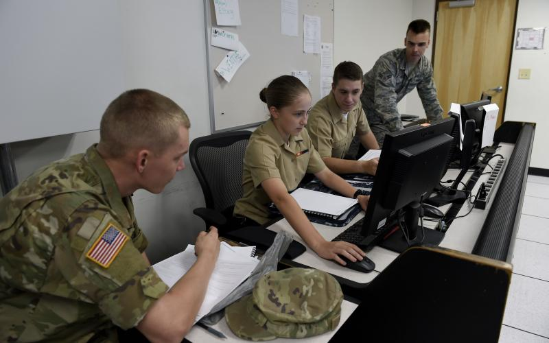 Two Navy cryptologic technicians track a target of interest from the electronic warfare combat direction center of the USS Dwight D. Eisenhower. Electronic warfare, signals intelligence and cyber increasingly are overlapping in combat operations.