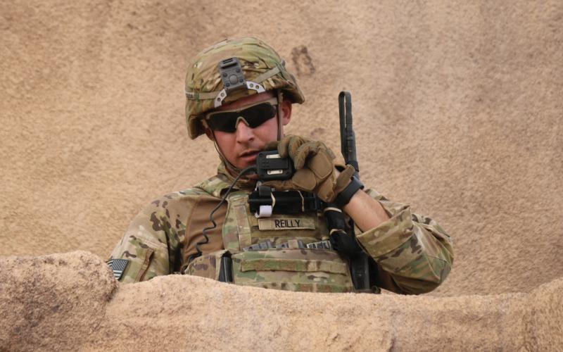 A U.S. Army infantryman radios his situation report during an exercise. Future defense communications systems are likely to be smaller and more comprehensive as the military and industry collaborate on new information technology capabilities that help the warfighter in the battlespace. Credit: Capt. Lindsay Roman, USA