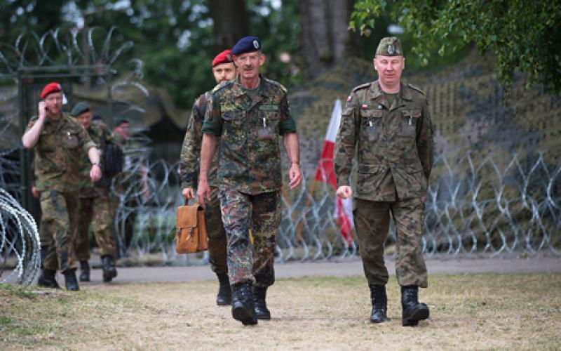 Maj. Gen. Thomas Franz, GEAF, former commander of the NATO Communications and Information Systems Group (NCISG) (c), walks with other participants during Steadfast Cobalt 15. About 39 organizations from 25 nations contributed to the exercise.