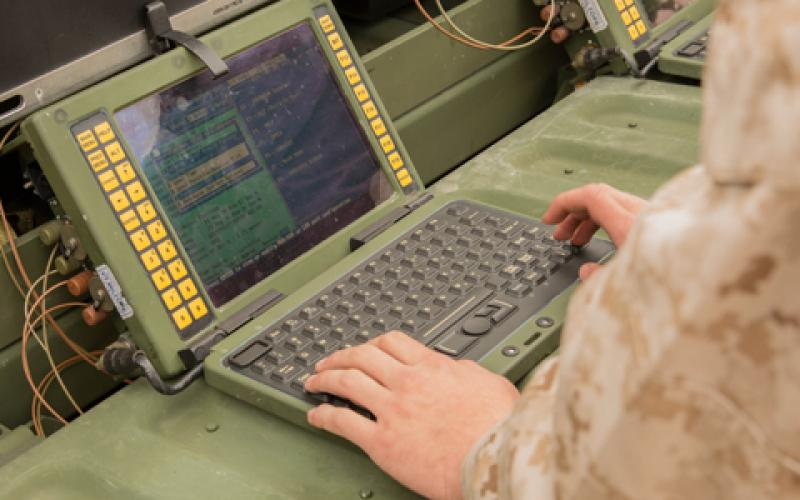 A U.S. Marine corporal at Camp Lejeune, North Carolina, works to set up a network so he and other Marines can share information via satellite. The Corps is working to ensure that capabilities Marines have in garrison can be taken to the field and operated seamlessly during a deployment.