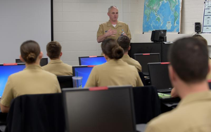 Adm. Scheidt discusses information warfare with officers attending the cryptologic warfare officer basic course at the Warfare Training Command. The Navy includes cryptology along with meteorology, communications and general intelligence in its information warfare portfolio.  U.S. Navy photo