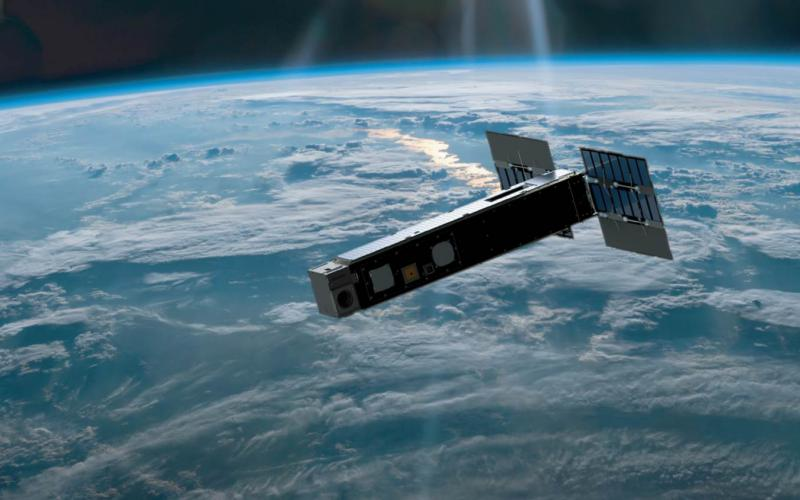 An artist's concept shows the Biarri-Point GPS cube satellite, developed by the United States and Australian researchers, in orbit. Australia and the United States are increasing their cooperation in satellite development to ensure smoother collaboration during military operations.