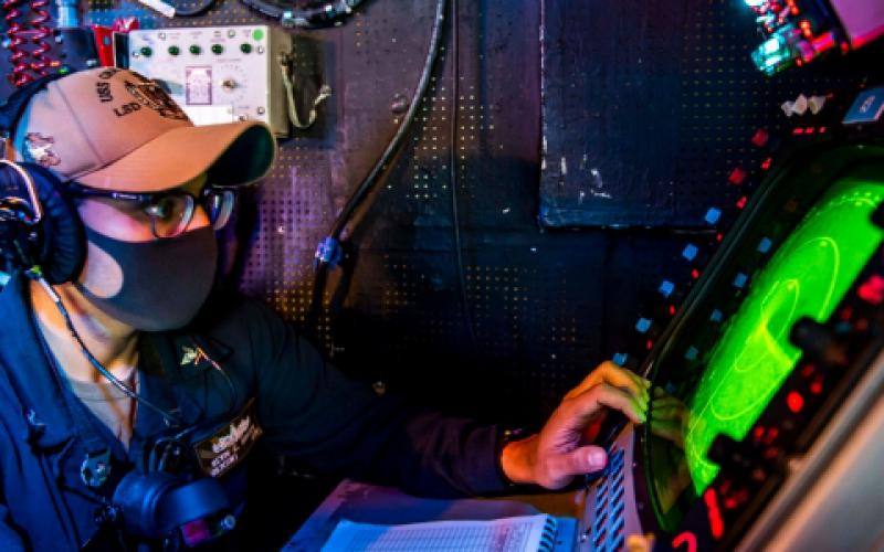 A U.S. Navy operations specialist uses a radar system in a combat information center in the 7th Fleet area of operations. The U.S. Navy's PEO C4I and Space Systems is focusing on parallel development of digital assets and capabilities to speed innovation to the fleet. Credit: U.S. Navy
