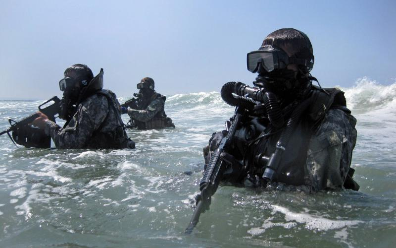 A group of special operations forces (SOF) divers trains in seaborne infiltration techniques. As adversaries become more sophisticated, SOF operations must rely more on flexible and resilient networking capabilities.