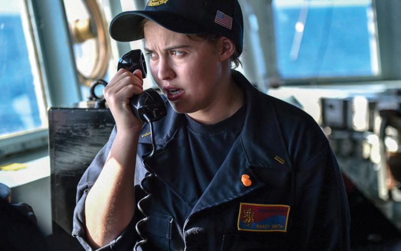 A U.S. Navy ensign uses a bridge-to-bridge radio to speak with a patrol craft crew in the Philippine Sea. With radio spectrum demands limiting Navy communications, light-based systems may emerge for internal and local communication needs. Credit: U.S. Navy photography by Mass Communications Spec. 1st Class Benjamin Dobbs, USN