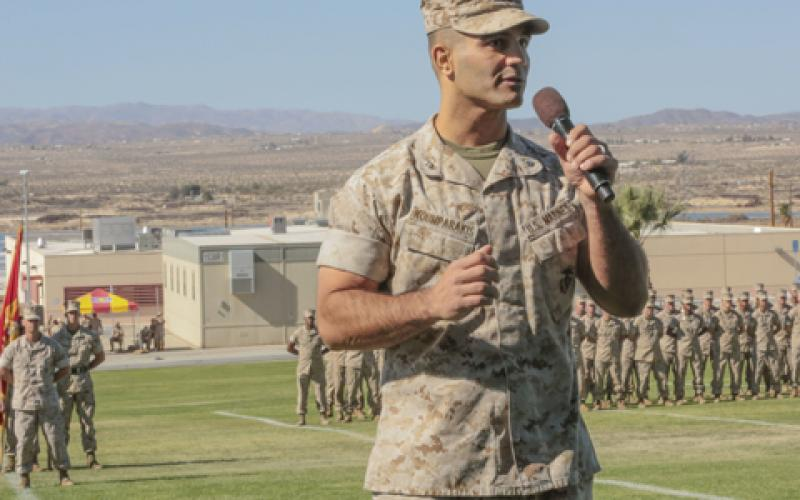 Lt. Col. Speros C. Koumparakis, USMC, commanding officer of the communication training battalion (CTB) in the Marine Corps Communication-Electronics School (MCCES), addresses the audience during the CTB's activation ceremony in March. The CTB, along with the air control training squadron (ACTS), have been consolidated under the MCCES at a single facility in Twentynine Palms, California.