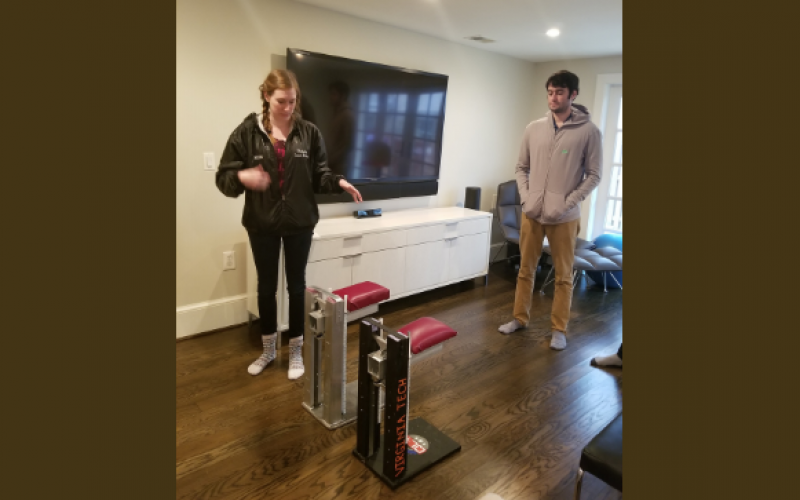Virginia Tech students work on a device that allows a veteran missing an arm to do pushups and planks in her home. The Quality of Life Plus (QL+) program brings together injured veterans and engineering students who craft solutions to physical challenges the warriors face.  QL+ photo