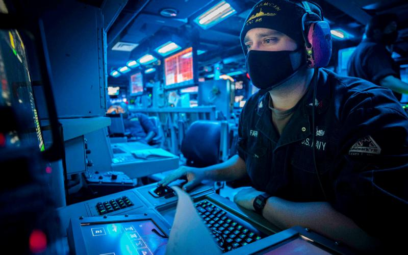 A sonar technician simulates counterfire during an antisubmarine warfare drill aboard the Arleigh Burke-class guided missile destroyer USS John S. McCain. The Navy is exploring advances in machine learning and artificial intelligence to deal with the rapidly increasing amount of sensor data flooding naval intelligence systems.  U.S. Navy photo