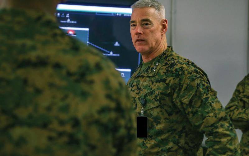 Lt. Gen. Brian D. Beaudreault, USMC, commanding general, II Marine Expeditionary Force, receives a brief during the end of Cyber Fury 2020 at Camp Lejeune, North Carolina. Cyber Fury is an annual training exercise that allows Marines to simulate a series of cyberspace attacks by identifying and countering them. Credit: Lance Cpl. Haley McMenamin, USMC