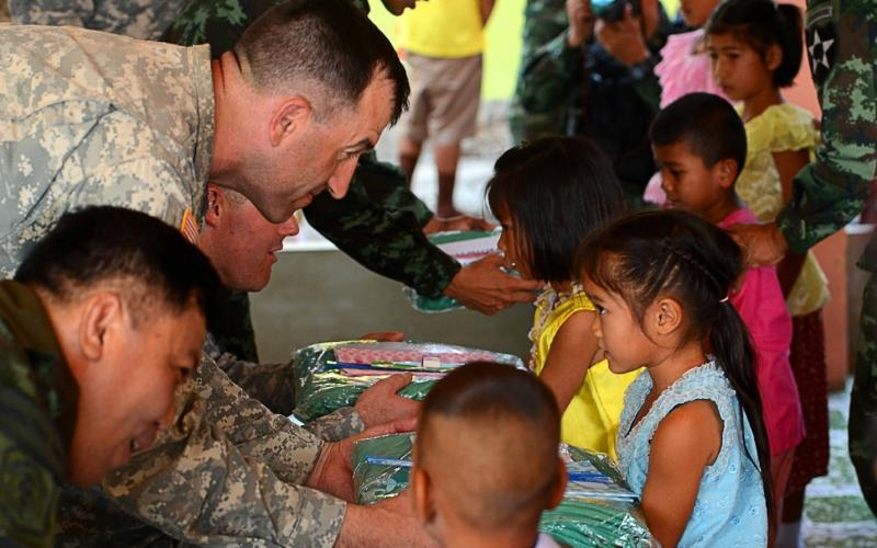 Col. David Foley, USA, commander of 1-2 Stryker Brigade Combat Team, distributes supplies during a medical engagement in February during Cobra Gold 2016, a training exercise between U.S. and Thai forces that is part of Pacific Pathways.