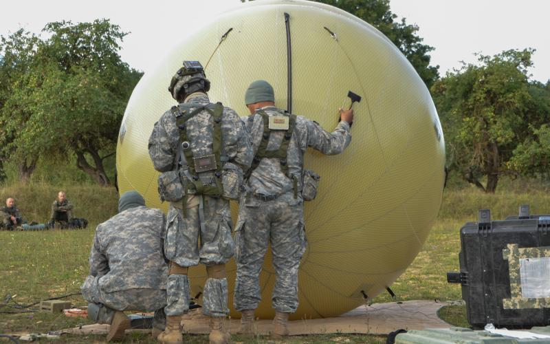 U.S. soldiers adjust a GATR 2.4-meter antenna in Hohenfels, Germany. Pacific-based troops deployed similar equipment to gain expeditionary communications during recent Pacific Pathways exercises.