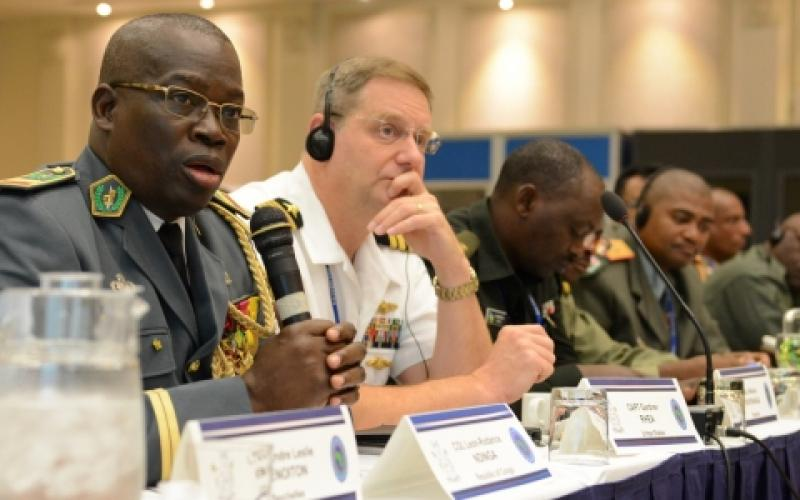 Col. Leon-Rodance Ndinga from the Republic of Congo comments during a tabletop exercise at AE 2015 in Botswana. AE is an annual 10-day communications seminar designed to increase interoperability between partner nations to support United Nations and African Union peacekeeping, disaster response and humanitarian assistance missions.