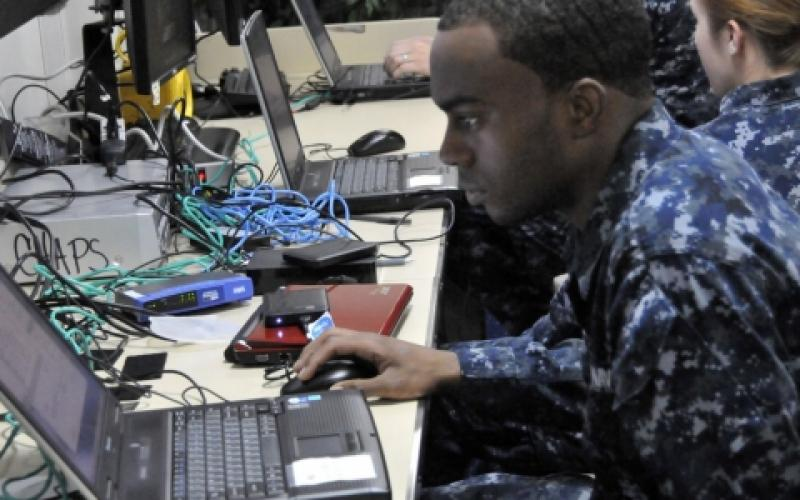 A U.S. sailor aboard the amphibious assault ship USS Boxer sets up a virtual server administrator account during a training course provided by the Space and Naval Warfare Systems (SPAWAR) Command. The command furnishes fleets with fly-away network operations support teams that offer tailored, hands-on information technology and information assurance training to maintain command, control, communications and computers readiness.