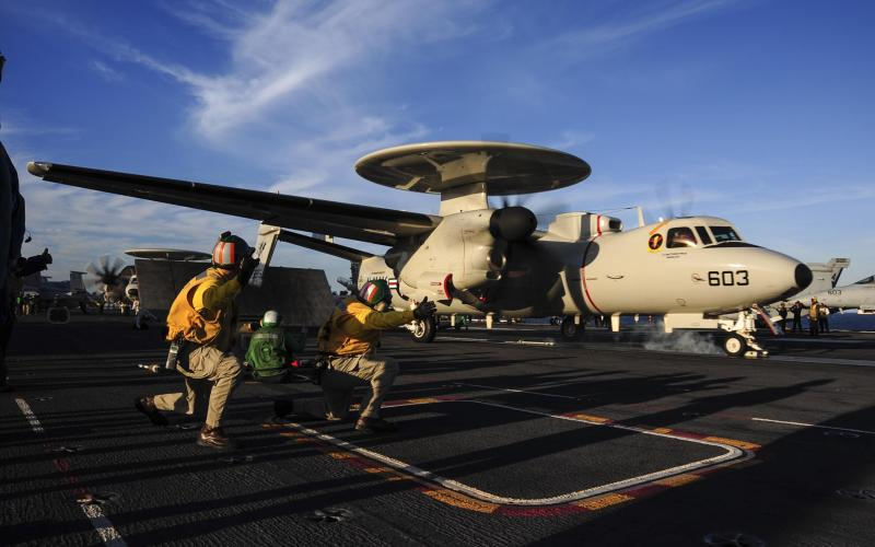 An E-2D Hawkeye assigned to the Tiger Tails of Carrier Airborne Early Warning Squadron (VAW) 125 launches off the flight deck of the aircraft carrier USS Theodore Roosevelt in October 2014.