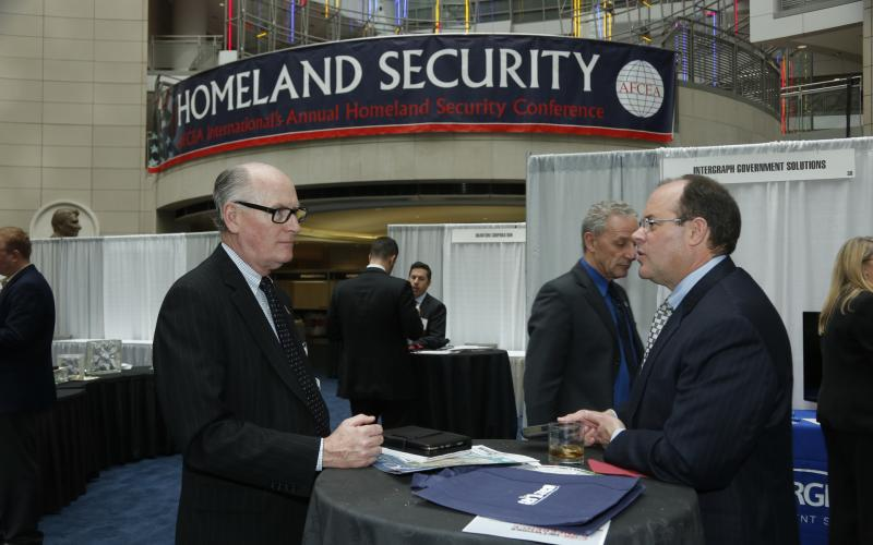 Attendees of the Homeland Security Conference, held in March in Washington, D.C., talk in the exhibit hall. Photography by Michael Carpenter
