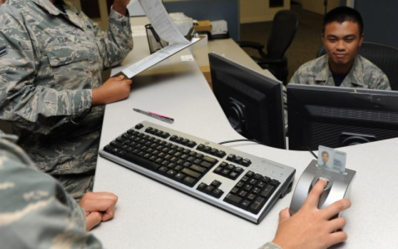 A U.S. airman with the 81st Force Support Squadron resets her common access card (CAC) personal identification number. U.S. Air Force photo by Kemberly Groue
