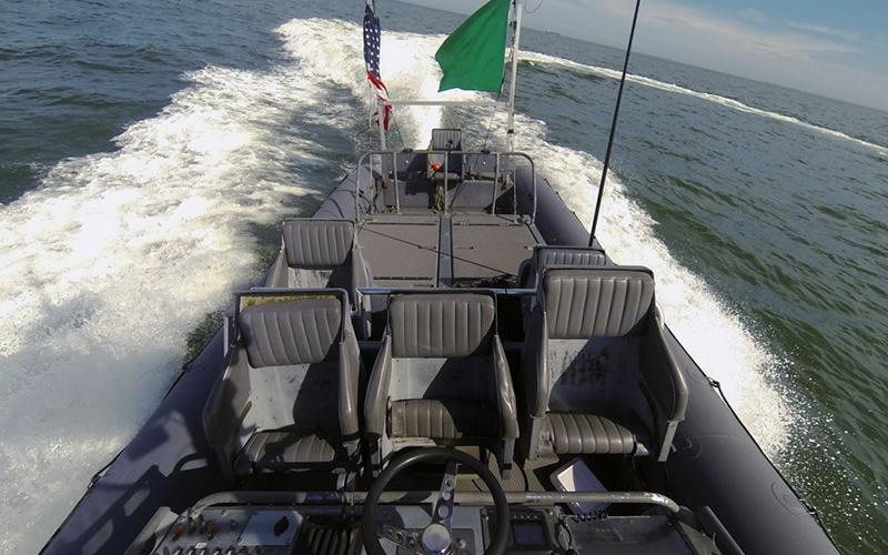 An unmanned rigid-hull inflatable boat operates autonomously during an Office of Naval Research (ONR)-sponsored demonstration of swarmboat technology at Virginia's Joint Expeditionary Base Little Creek-Fort Story. During the demonstration, four boats used an ONR-sponsored system called Control Architecture for Robotic Agent Command and Sensing to run autonomously during various scenarios designed to identify, trail or track a target.