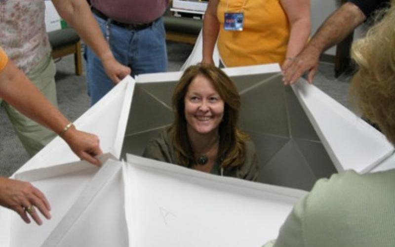 Ongoing professional development is an avenue to increasing an educator's own content knowledge and teaching strategies, says Christine Royce, who finds herself in the middle of a geodesic dome as part of a NASA Ambassadors training program.