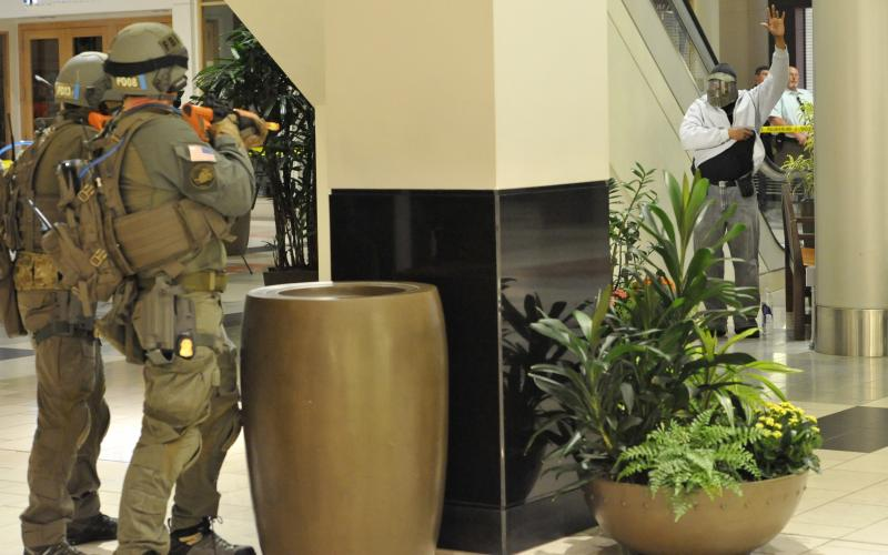 The FBI's Portland, Oregon, SWAT team participates in a threat response exercise in 2014 at Washington Square shopping mall. More and more businesses must contend with the growing cluster of terror, cyber and insider threats.