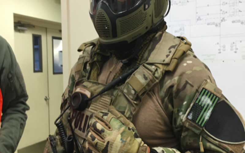A fully equipped police SWAT team member wears Intel's Recon Jet eyewear. Live video from Recon Jet's camera can be shared with a command post or other team members.