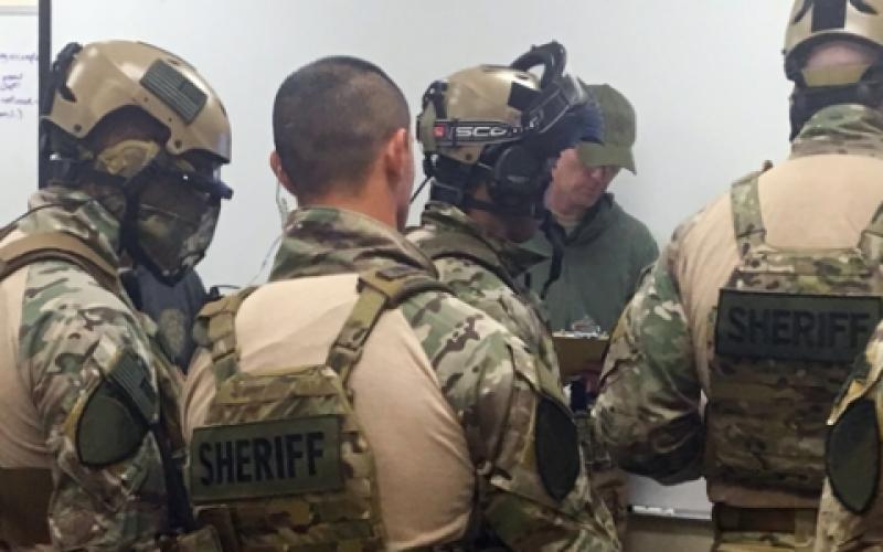 SWAT teams receive a training scenario briefing during September's Urban Shield in California.