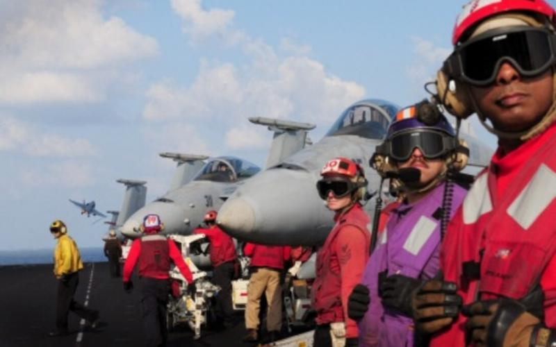 Sailors stand by while an F/A-18 Hornet launches from the flight deck of Nimitz-class aircraft carrier USS Dwight D. Eisenhower in 2012. The Navy's use of modular open architecture solutions allows the service to bring rapid updates to legacy platforms, including as part of its F/A-18 Distributed Targeted Processor-Networked effort.  U.S. Navy photo by Mass Communication Specialist Seaman Sabrina Fine
