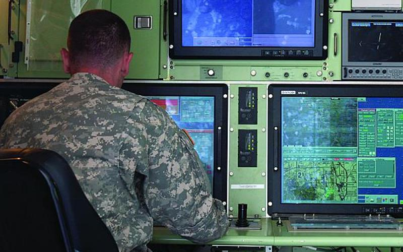 An unmanned aerial vehicle (UAV) operator monitors RQ-7 Shadow UAV operations during an exercise. Defense researchers are developing new control software to defeat an increasing threat of cyber attack on unmanned systems.