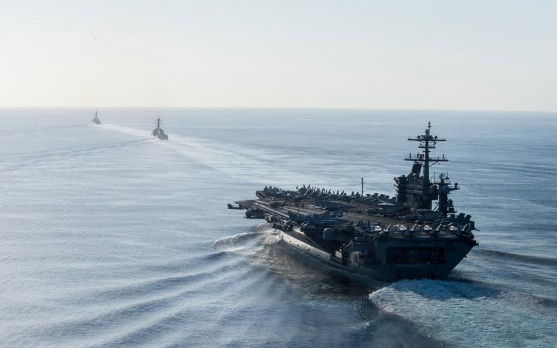 Ships from the USS Theodore Roosevelt carrier strike group participate in a simulated strait transit exercise May 11 in the Pacific Ocean. Photo by Petty Officer 2nd Class Paul Archer, USN