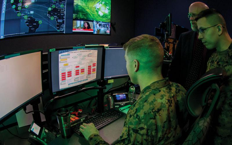 Marines with Marine Corps Forces Cyberspace Command work in the cyber operations center at Lasswell Hall, Fort Meade, Maryland. MARFORCYBER Marines conduct offensive and defensive cyber operations in support of U.S. Cyber Command and operate, secure and defend the Marine Corps Enterprise Network. Credit: Staff Sgt. Jacob Osborne, USMC