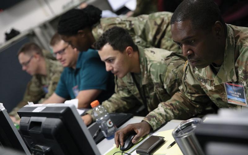 U.S. service members and civilians, along with partner nation service members, work to improve tactical-level cyber operations skills against a live opposing force at the Joint Training Facility in Suffolk, Virginia, during a U.S. Cyber Command annual exercise.