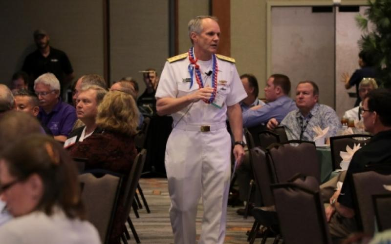 Adm. Phillip G. Sawyer, USN, commander, U.S. Pacific Fleet, walks among the audience as he gives Monday's keynote luncheon address during TechNet Asia-Pacific 2015.