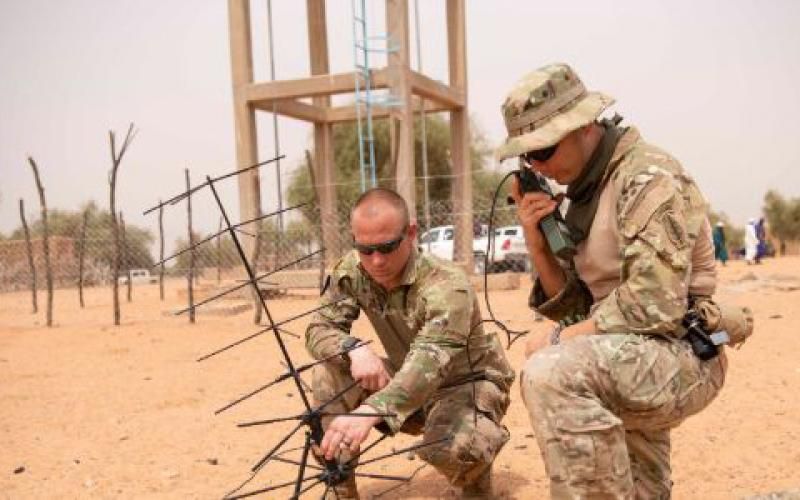 Army Staff Sgt. Andrew Kirchoff, left, and Staff Sgt. Roberto Carlos Ramirez operate a satellite communication antenna in Kaedi, Mauritania, February 2020, during Flintlock. The modern warfighter must remain light and agile and enjoy ease of communication, highlighting the necessity for and relevance of devices such as the Global Rapid Response Information Package.  Army Cpl. Kevin Payne