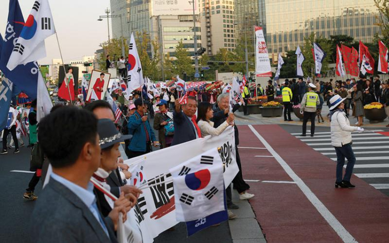 Influence operations in the invisible world of cyberspace have real-world consequences. After South Koreans heard about the disinformation campaign that helped elect Park Geun-hye as the republic's president, they took to the streets to protest against the government. Credit: Steve Edreff/Shutterstock.com