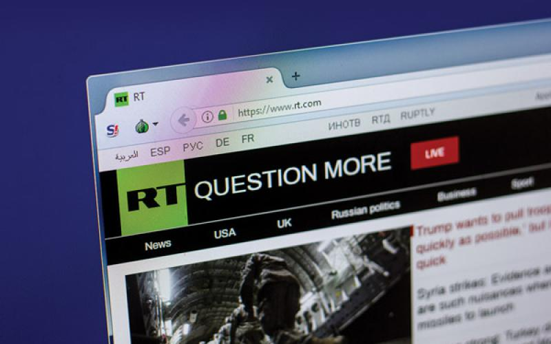 RT, an international television network funded by the Russian government, encourages viewers to be skeptical about the information they read. Credit: Sharaf Maksumov/Shutterstock.com