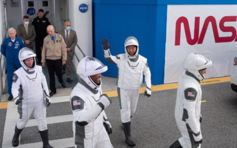 NASA astronauts Shannon Walker (l), Victor Glover (second from l), Japan Aerospace Exploration Agency (JAXA) astronaut Soichi Noguchi (second from r), and NASA astronaut Mike Hopkins (r), walk toward their SpaceX Crew Dragon spacecraft at NASA's Kennedy Space Center in Florida. The November launch was the first time NASA personnel had traveled into orbit aboard a commercial space vehicle.  NASA/Joel Kowsky via Flickr