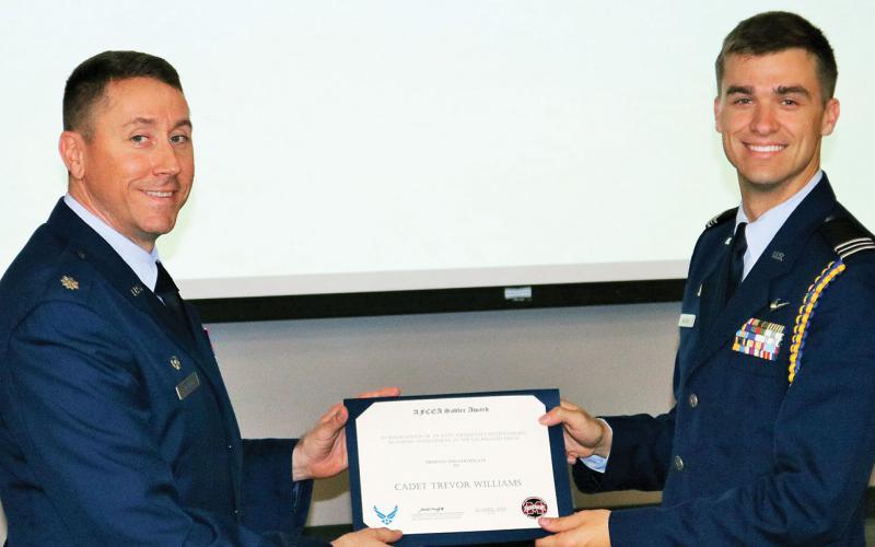 The Maj. Gen. Robert E. Sadler, USAF, Honor Award is presented to Cadet Trevor H. Williams (r) in April at Mississippi State University.