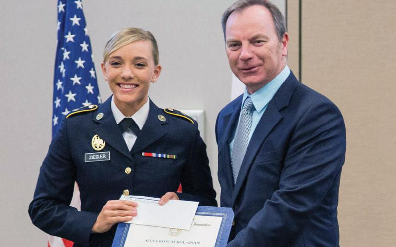 Cadet Paige Michele Ziegler (l), Embry-Riddle Aeronautical University, receives an AFCEA ROTC scholarship from Jason Irving, vice president of scholarships for AFCEA's Orlando-Central Florida Chapter. The foundation's ROTC scholarships, ranging from $2,000 to $3,000 each, go to full-time students in a C4I-related major.