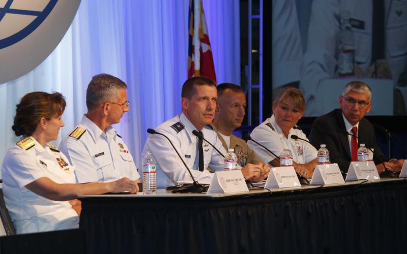 (l-r) Vice Adm. Jan E. Tighe, USN, U.S. Fleet Cyber Command; Rear Adm. Marshall B. Lytle III, USCG, Coast Guard Cyber; Brig. Gen. Robert J. Skinner, USAF, Air Forces Cyber; Col. Dewey Jordan, USMC, Marine Forces Cyber Command; Col. Jennifer G. Buckner, USA, U.S. Army Cyber Command; and panel moderator Lt. Gen. Rhett Hernandez, USA (Ret.), West Point Cyber Research Center.