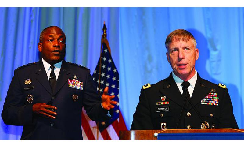 Lt. Gen. Ronnie D. Hawkins Jr., USAF (l), director, Defense Information Systems Agency, and Lt. Gen. Mark S. Bowman, J-6, The Joint Staff, offer presentations at the JIE Mission Partner Symposium.