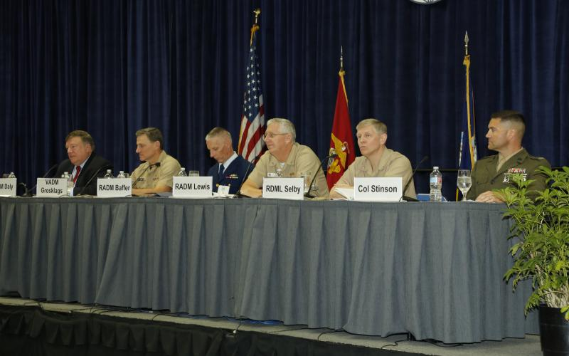Discussing how to bring capabilities to the warfighters are (l-r) panel moderator Vice Adm. Peter H. Daly, USN, (Ret.), U.S. Naval Institute CEO; Vice Adm. Paul A. Grosklags, USN, NAVAIR; Rear Adm. Bruce Baffer, USCG; Rear Adm. David H. Lewis, USN, SPAWAR; Rear Adm. Lorin Selby, USN, NSWC; and Col. Benjamin P. Stinson, USMC, MCTSSA.