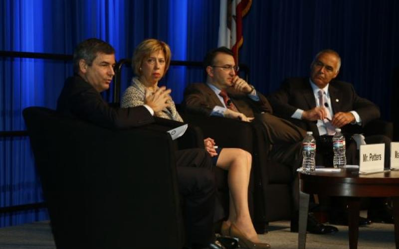 (l-r) Mike Petters, president and CEO, Huntington Ingalls Industries; Ellen Lord, president and CEO, Textron Systems Corporation; Jeffrey T. Napoliello, vice president, strategy and business development, Lockheed Martin Mission Systems and Training; and panel moderator Al Grasso, president and CEO, The MITRE Corporation, discuss issues related to the defense industrial base.