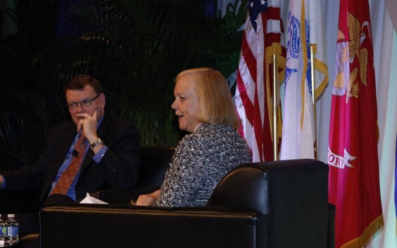 Meg Whitman (r), president and CEO, Hewlett Packard Enterprise, gives an industry perspective as Terry Halvorsen, U.S. Defense Department CIO, listens.