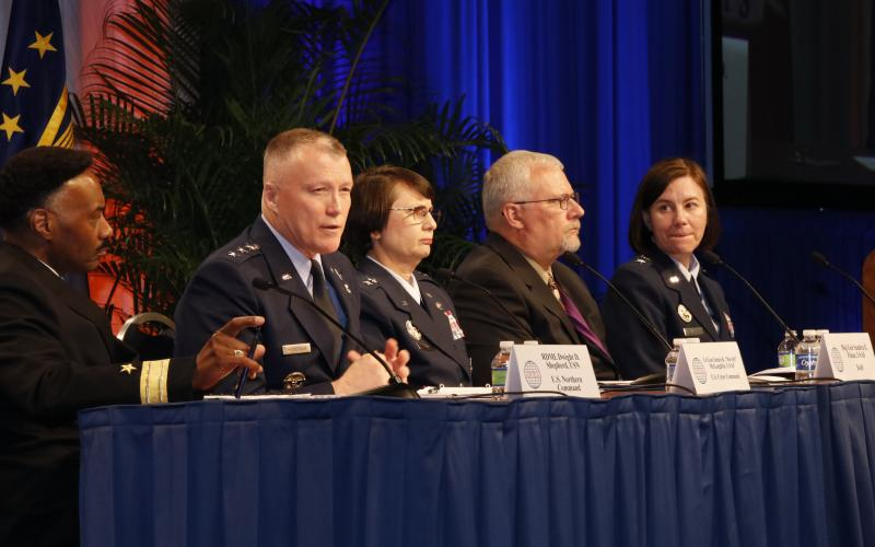 Discussing cooperative cybersecurity efforts are (l-r) Rear Adm. Dwight D. Shepherd, USN, NORAD/NORTHCOM; Lt. Gen. Kevin McLaughlin, USAF, U.S. Cyber Command; Maj. Gen. Sandra E. Finan, USAF, U.S. Defense Department; Dean S. Betzer, U.S. Special Operations Command; and moderator Maj. Gen. Sarah E. Zabel, USAF, DISA.